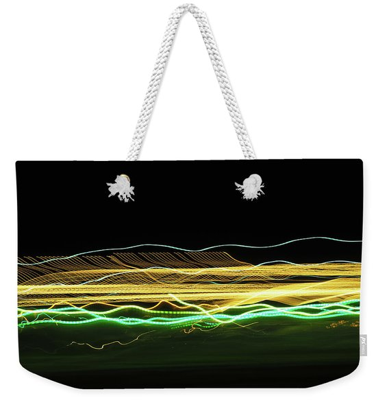 Weekender Tote Bag featuring the photograph Feather by Scott Cordell