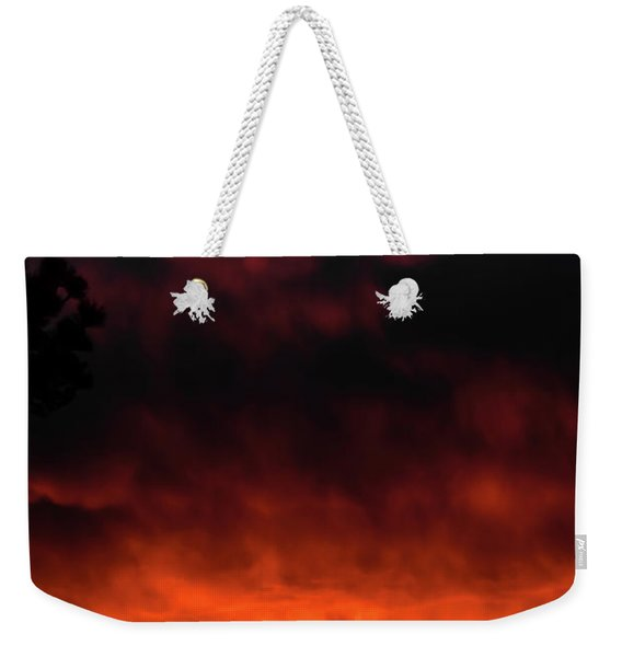 Weekender Tote Bag featuring the photograph Fiery Sky by Jason Coward