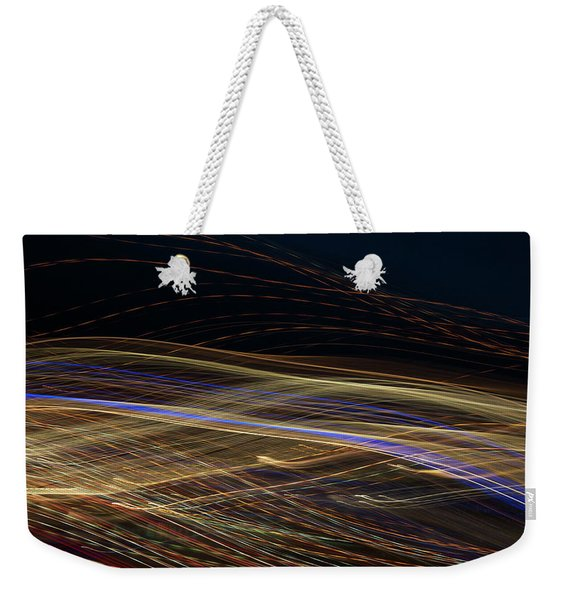 Weekender Tote Bag featuring the photograph Flowing by Michael Lucarelli