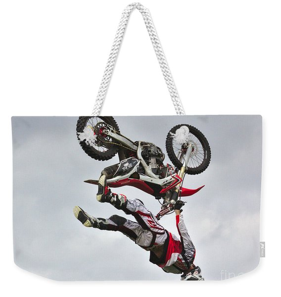Weekender Tote Bag featuring the photograph Flying Inverted by Jeremy Hayden