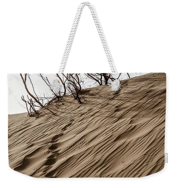 Weekender Tote Bag featuring the photograph Footprints  by Arik Baltinester