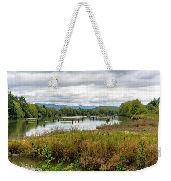 Weekender Tote Bag featuring the photograph fort Clatsop on the Columbia River by Michael Hope