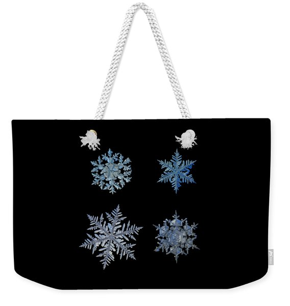 Four Snowflakes On Black Background Weekender Tote Bag