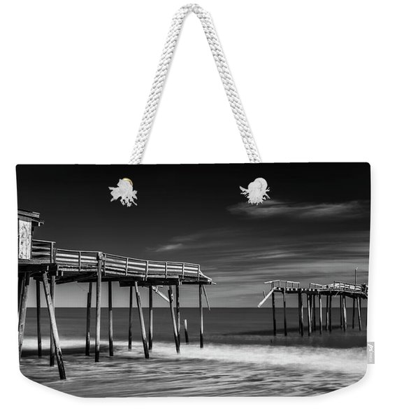 Weekender Tote Bag featuring the photograph Frisco Fishing Pier In Black And White Panorama by Ranjay Mitra