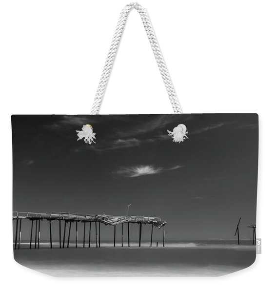 Weekender Tote Bag featuring the photograph Frisco Pier In North Carolina And Clouds In Black And White by Ranjay Mitra