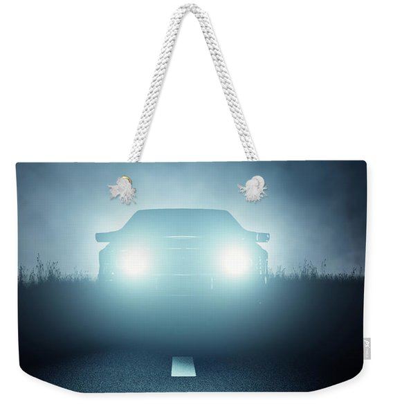 Front Car Lights At Night On Open Road Weekender Tote Bag