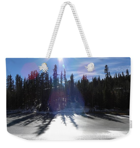 Weekender Tote Bag featuring the photograph Sun Reflecting Kiddie Pond Divide Co by Margarethe Binkley