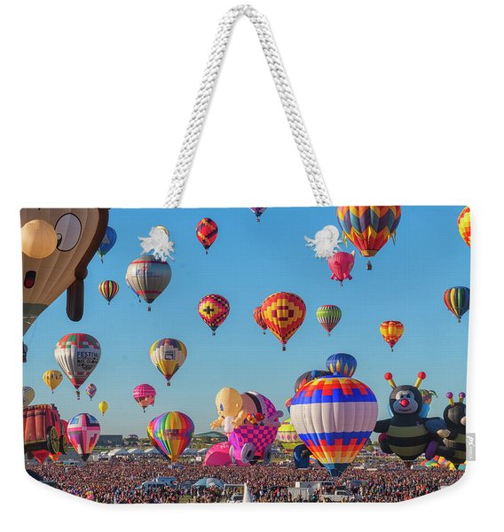 Weekender Tote Bag featuring the photograph Funky Balloons by Tom Singleton