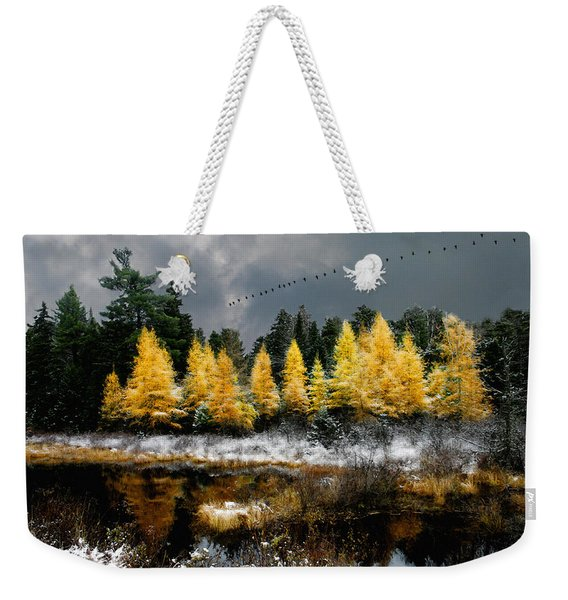 Weekender Tote Bag featuring the photograph Geese Over Tamarack by Wayne King
