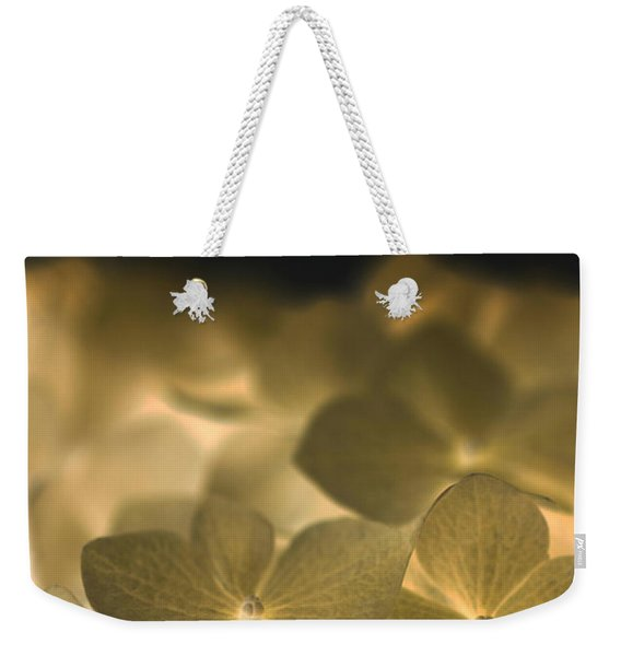 Weekender Tote Bag featuring the photograph Glow Blossoms by Writermore Arts