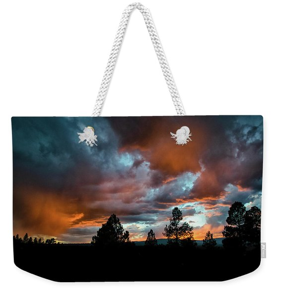 Weekender Tote Bag featuring the photograph Glowing Mists by Jason Coward