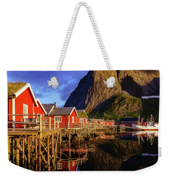 Weekender Tote Bag featuring the photograph Golden Hour In Reine by Dmytro Korol