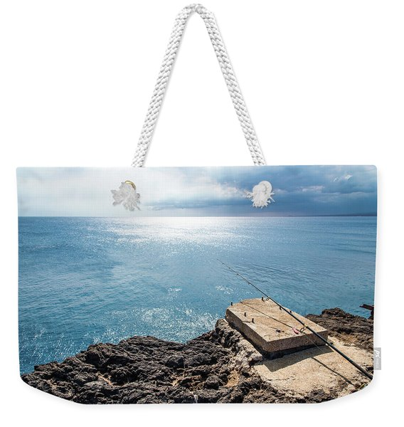 Weekender Tote Bag featuring the photograph Gone Fishing by Break The Silhouette