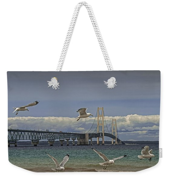 Gulls Flying By The Bridge At The Straits Of Mackinac Weekender Tote Bag
