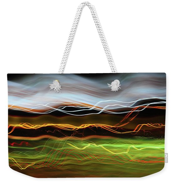 Weekender Tote Bag featuring the photograph Halo by Scott Cordell