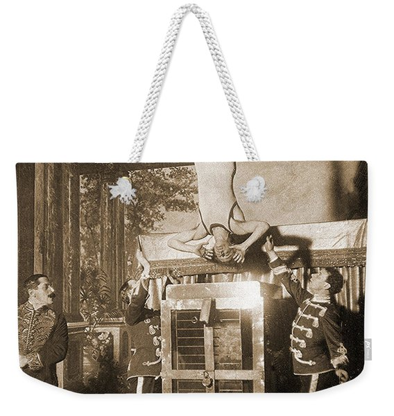 Harry Houdini Suspended Above A Tank Of Water  Weekender Tote Bag