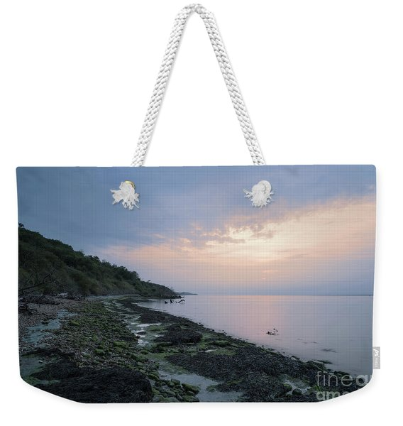 Weekender Tote Bag featuring the photograph Hazy Sunset by Clayton Bastiani