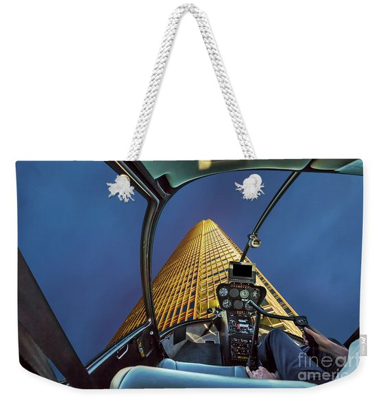 Weekender Tote Bag featuring the photograph Helicopter On Skyscaper Facade by Benny Marty