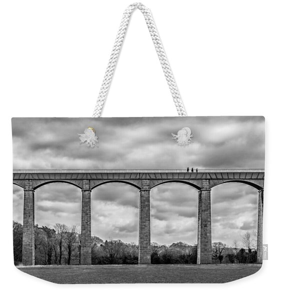 Weekender Tote Bag featuring the photograph Sky Walkers by Nick Bywater