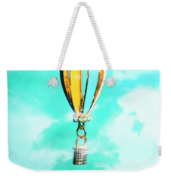Hot Air Balloon Pendant Over Cloudy Background Weekender Tote Bag