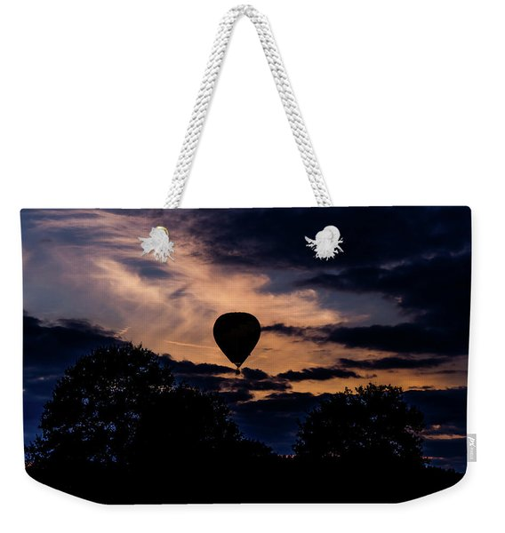 Weekender Tote Bag featuring the photograph Hot Air Balloon Silhouette At Dusk by Scott Lyons