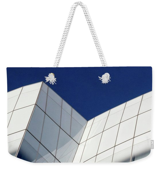 Weekender Tote Bag featuring the photograph Iac Sky by Eric Lake