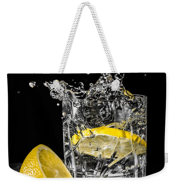 Weekender Tote Bag featuring the photograph Ice And A Slice by Nick Bywater