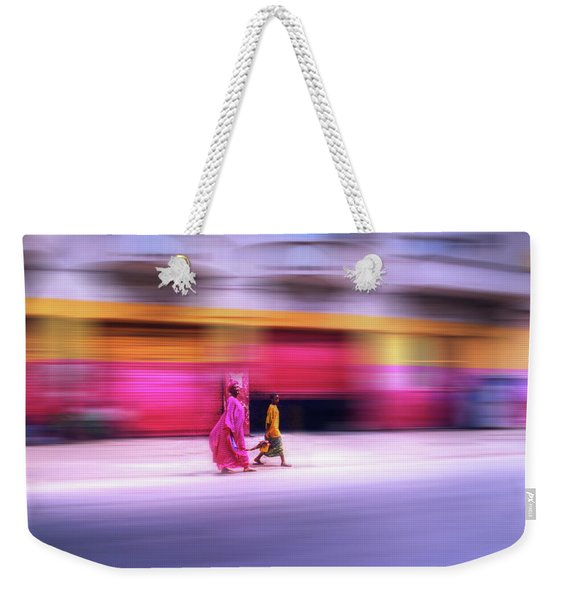 Weekender Tote Bag featuring the photograph In Sync In Senegal by Wayne King