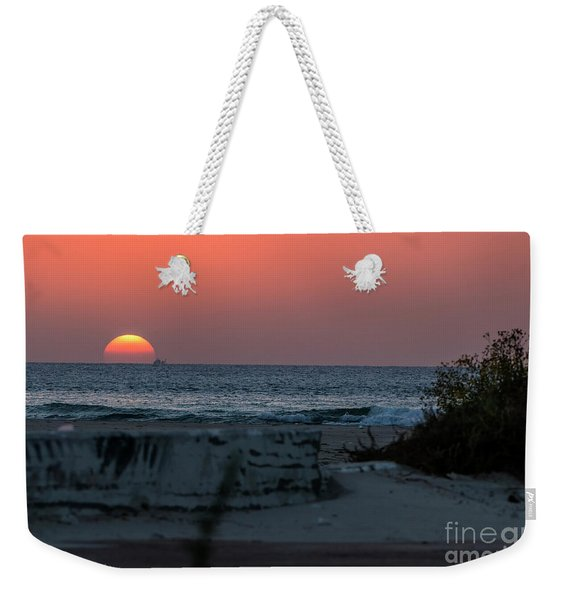 Weekender Tote Bag featuring the photograph It's The End Of The Day by Arik Baltinester