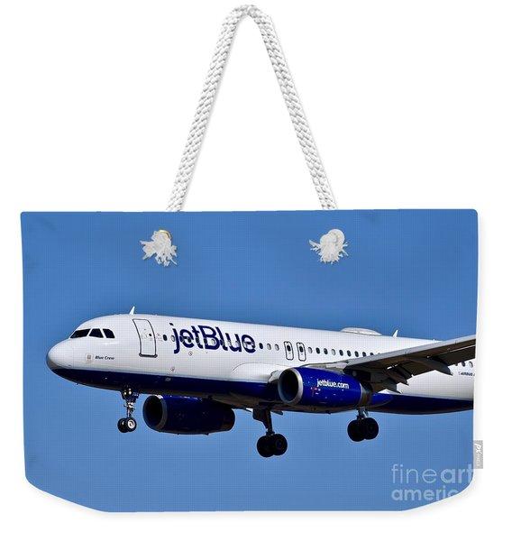 jetBlue Airlines plane in flight Weekender Tote Bag