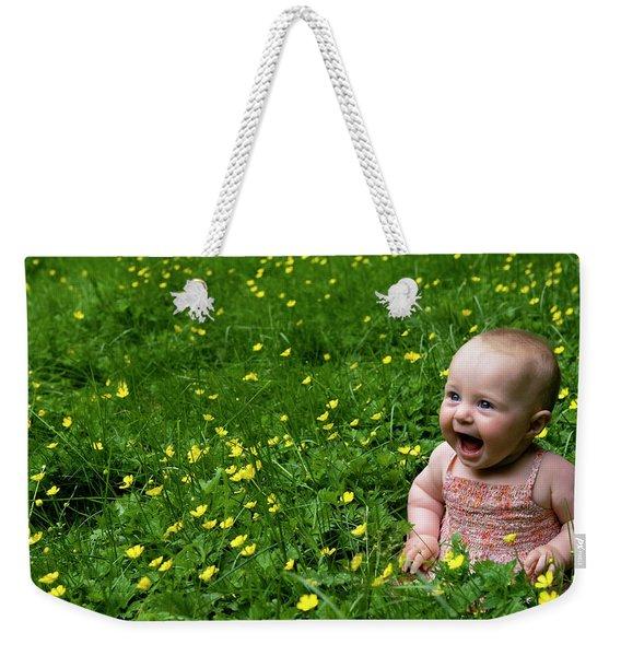 Weekender Tote Bag featuring the photograph Joyful Baby In Flowers by Lorraine Devon Wilke