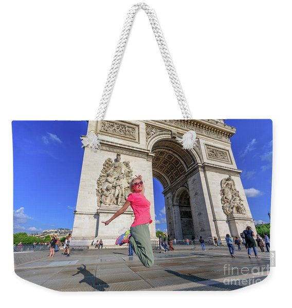 Weekender Tote Bag featuring the photograph Jumping At Arc De Triomphe by Benny Marty