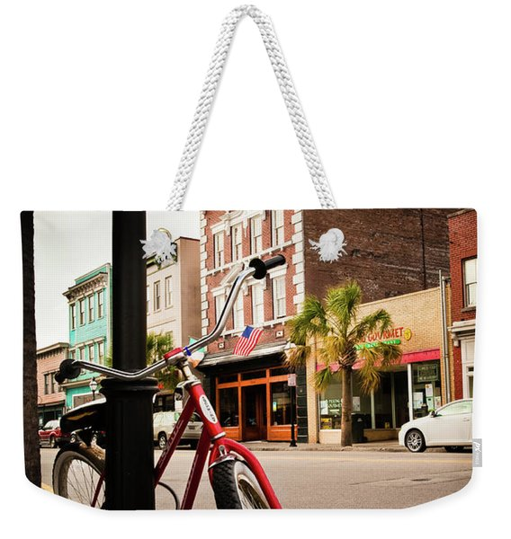 Weekender Tote Bag featuring the photograph King Street Charleston Sc  -7436 by John Bald