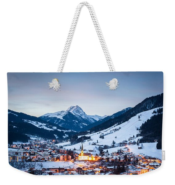 Weekender Tote Bag featuring the photograph Kirchberg Austria In The Evening by John Wadleigh