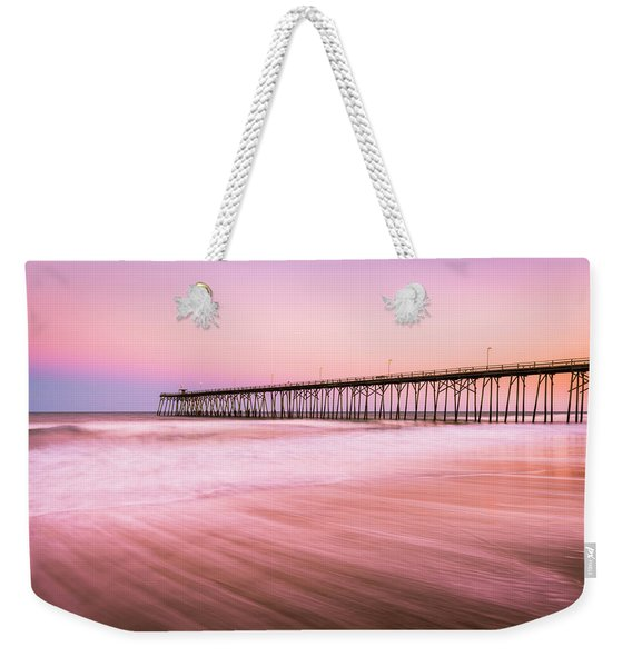 Weekender Tote Bag featuring the photograph Kure Beach Fishing Pier At Sunset by Ranjay Mitra
