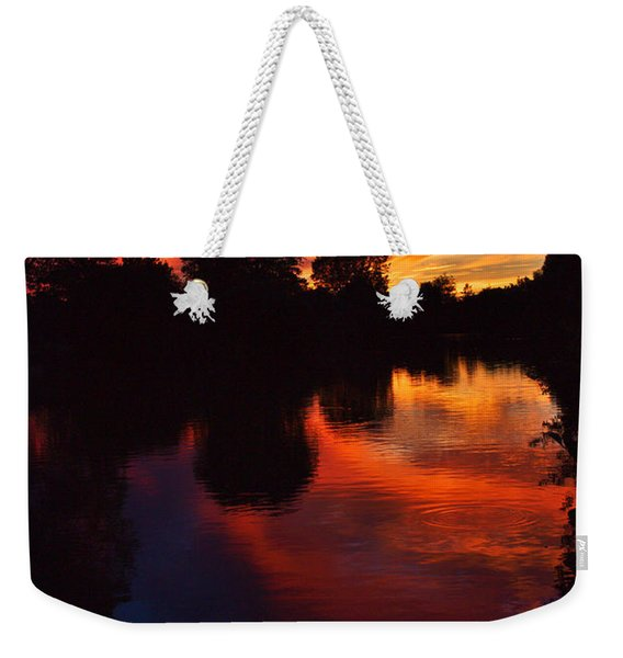 Weekender Tote Bag featuring the photograph Lake Sunset Reflections by Jeremy Hayden
