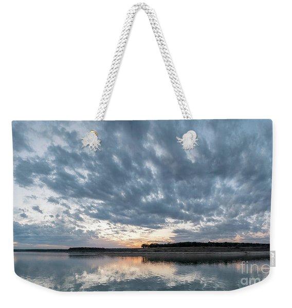 Large Panorama Of Storm Clouds Reflecting On Large Lake At Sunse Weekender Tote Bag
