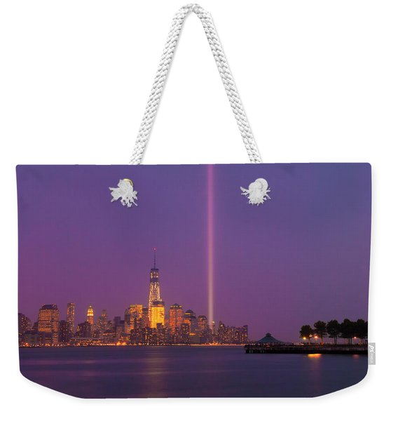 Weekender Tote Bag featuring the photograph Laser Twin Towers In New York City by Ranjay Mitra