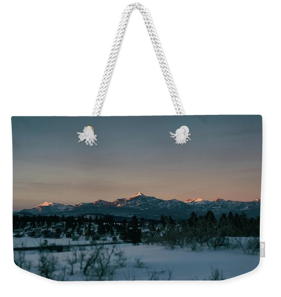 Weekender Tote Bag featuring the photograph Last Light On Pagosa Peak by Jason Coward