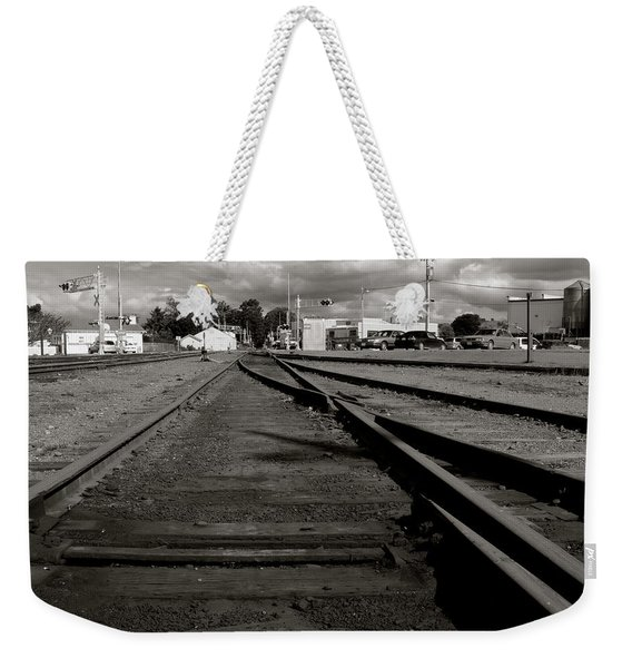 Weekender Tote Bag featuring the photograph Last Train Track Out by Lorraine Devon Wilke