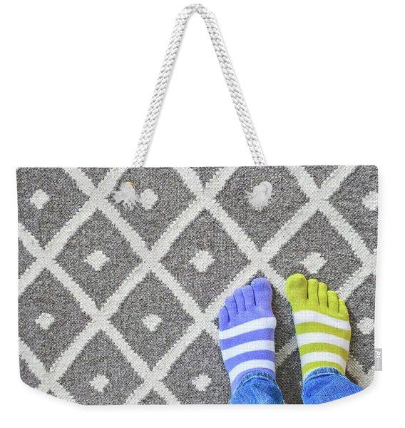 Legs In Mismatched Socks On Gray Carpet Weekender Tote Bag