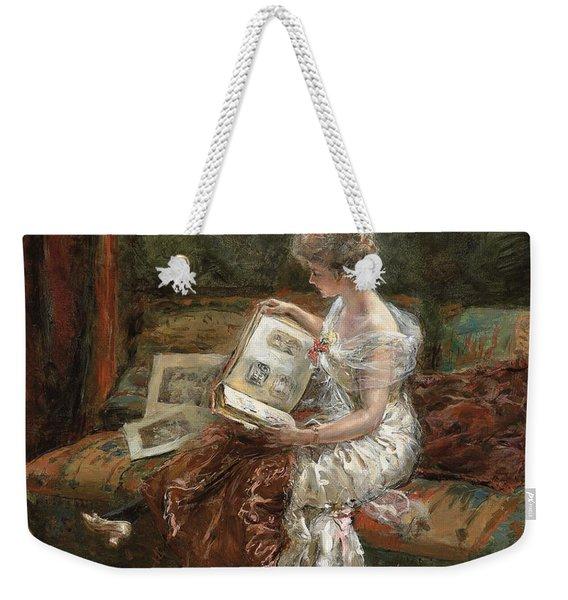 Leonie Garrido Looking At An Album Of Prints Weekender Tote Bag