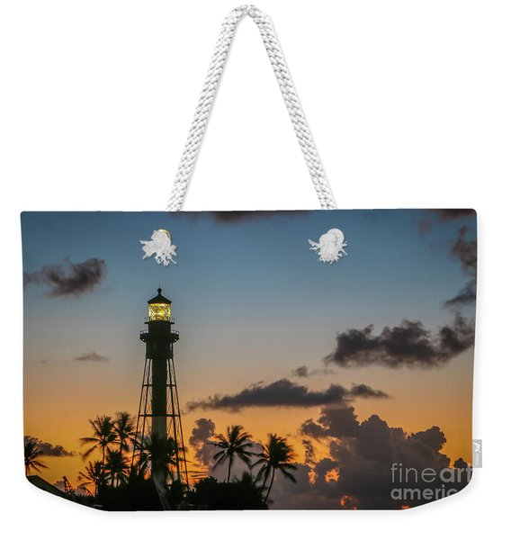 Weekender Tote Bag featuring the photograph Lighthouse At Dawn #1 by Tom Claud