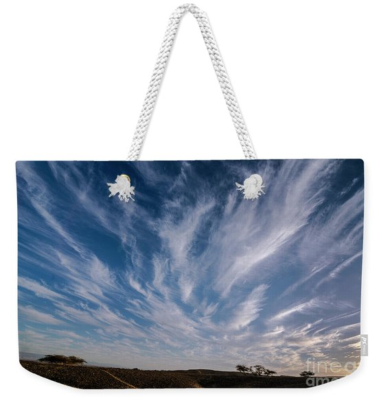 Weekender Tote Bag featuring the photograph Like Feathers In The Sky by Arik Baltinester