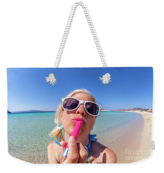 Weekender Tote Bag featuring the photograph Lipstick Applying by Benny Marty