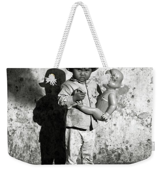 Little Vietnamese Girl Playing With Her Doll Weekender Tote Bag