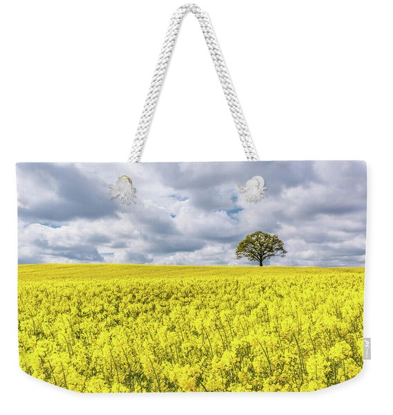 Weekender Tote Bag featuring the photograph Lone Beauty by Nick Bywater