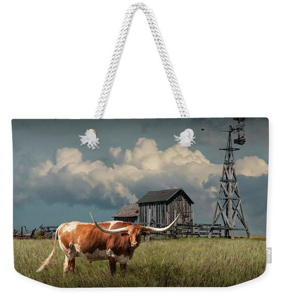 Longhorn Steer In A Prairie Pasture By Windmill And Old Gray Wooden Barn Weekender Tote Bag
