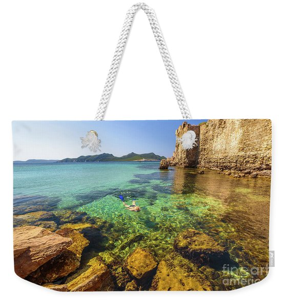 Weekender Tote Bag featuring the photograph Looking For Fishes by Benny Marty