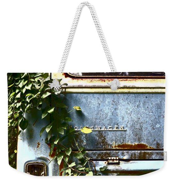 Weekender Tote Bag featuring the photograph Lost In Time by Carolyn Marshall
